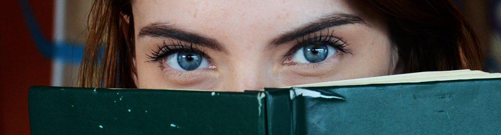 Blue eyes behind a book