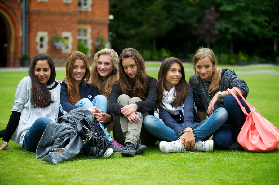students sitting on the grass - study medicine