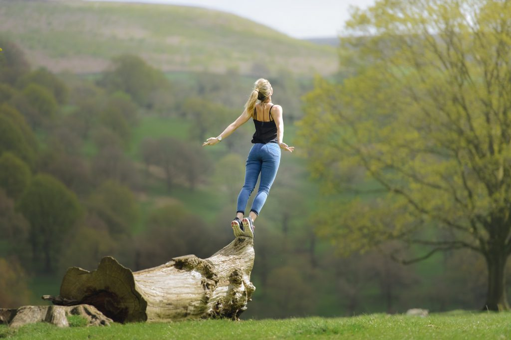 woman jumping from a tree